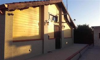 Casa legno lamellare con rivestimento in pietra Trinitapoli